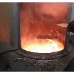 Burning off dirt in casting pot