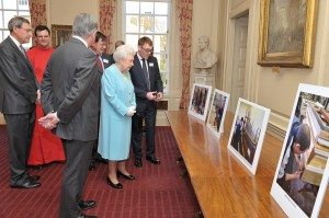 Andy Scott showing the Queen photos of the workshop
