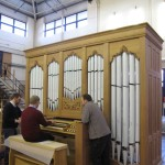 Duncan Mathews, Production Director, testing out the Hakadal Kirke organ overlooked by Andrew Scott, Head Voicer (left) and Jaraslav Strazovsky, Team Leader (right).
