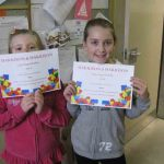 Tilly & Jessie with their certificates