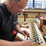 David Robinson working on the Great Reeds soundboard wellington