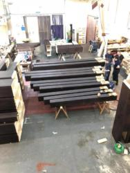 16ft octave having feet fitted and tuning slots cut.  The 32ft octave bottom and middle sections are to the left, and in the distance.