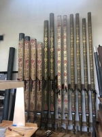 Having been silent since 1903, the front pipes are being restored and made to speak again.Photograph of the bottom octave of the Choir 8ft Open Diapason from the east case showing the decorated side