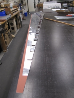 metal for Great Trumpet being cut