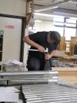 Owen sorting through pipes